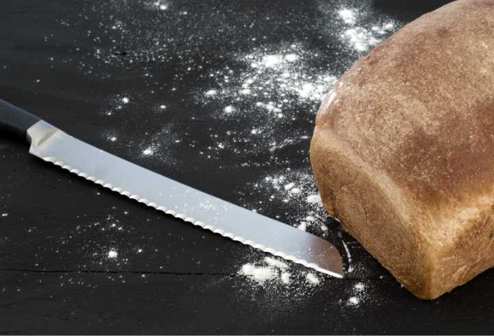 Bread knife with loaf of bread